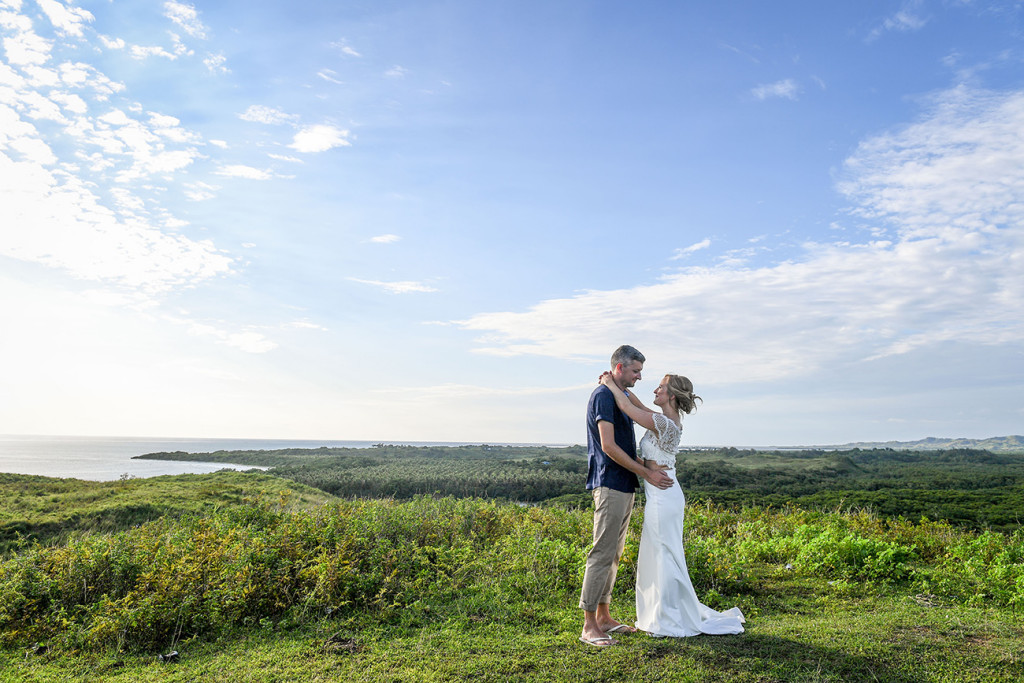 Bride and groom elope in green Fiji landscape