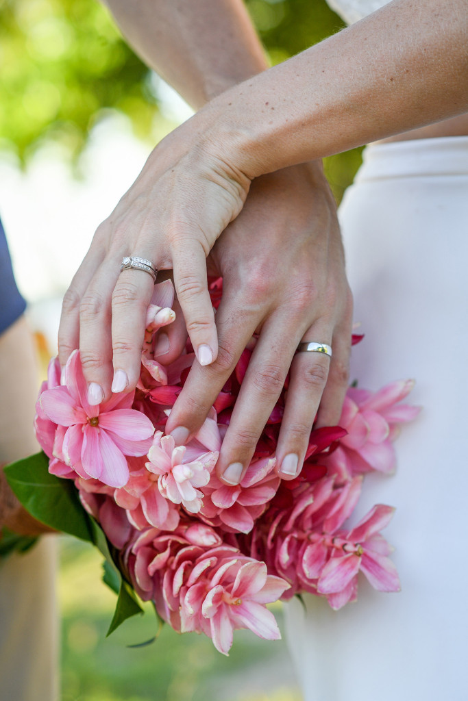 Fuschia bouqet and wedding rings Yatule Resort Fiji
