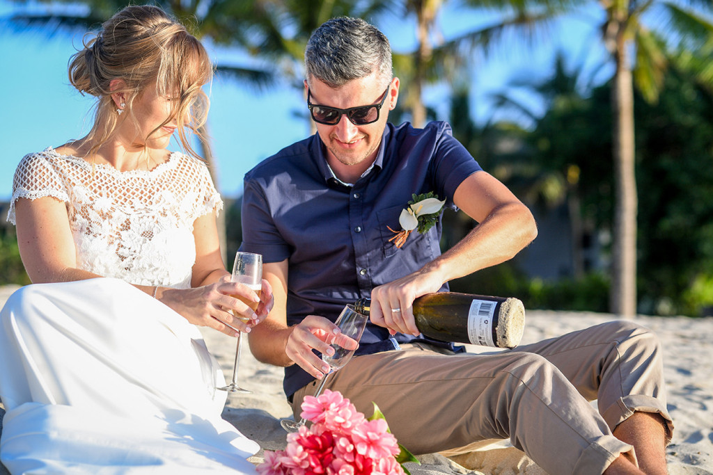 Married couple open the bubbly in Yatule Fiji Resort
