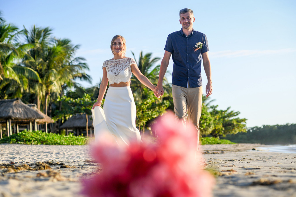 Eloped couple walk down the Coral Coast Fiji