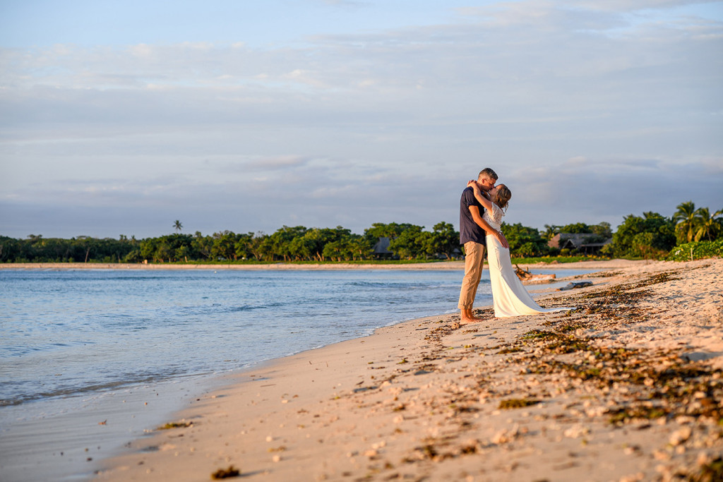Eloped couple kiss on Coral Coast Fiji
