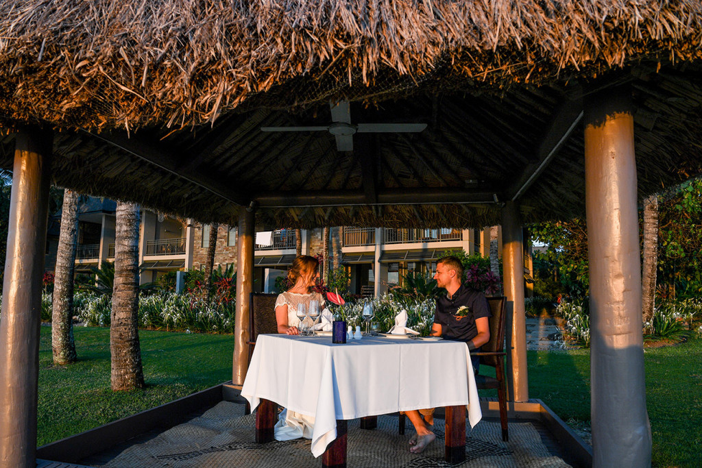 Eloped couple dinner in the sunset Yatule Fiji Resort