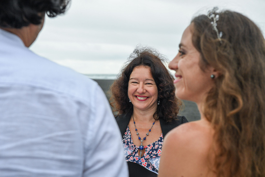 Cheerful celebrant officiates elopement wedding in Karekare Auckland NZ