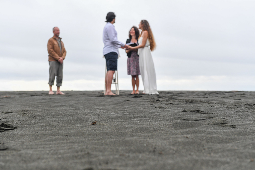Elopement wedding ceremony on Karekare Beach Auckland New Zealand