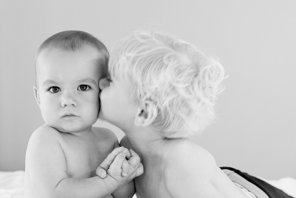 Cute black and white babies kiss before Vomo Resort Fiji wedding
