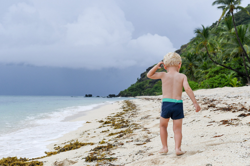 Baby walks down the beach of Vomo Island Resort Fiji