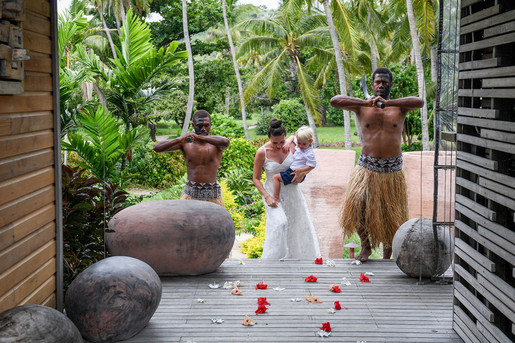 Traditional Fijian warriors watch as bride walks down the aisle.