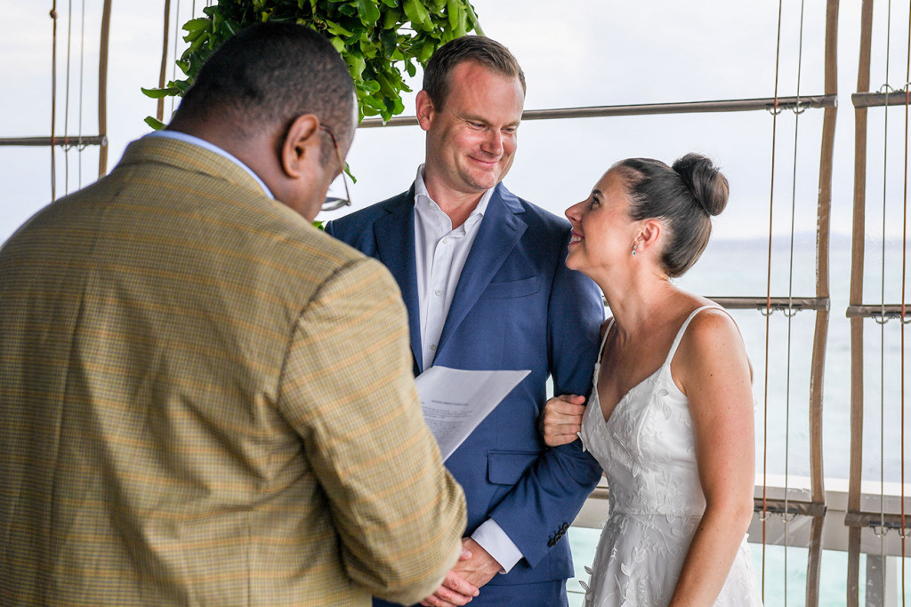 Bride and groom smile at each other in Fiji family wedding ceremony