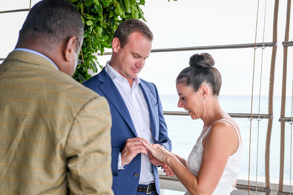 Couple exchanges rings at their Vomo Island Resort Fiji wedding