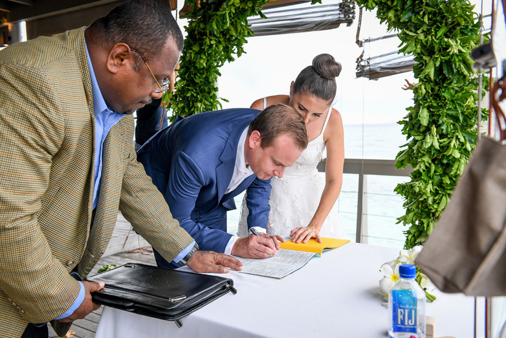 Signing marriage certificate in Vomo Island Resort Fiji wedding