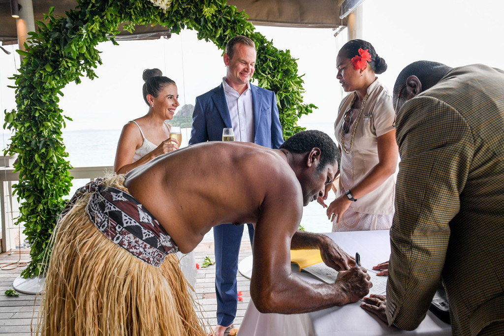 Fiji warrior signs marriage certificate in Vomo Island Resort Fiji