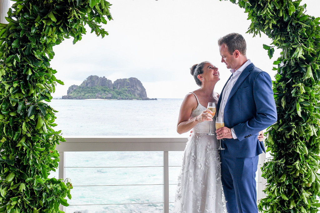 Loving couple overlooking pacific ocean at Vomo Island Resort Fiji