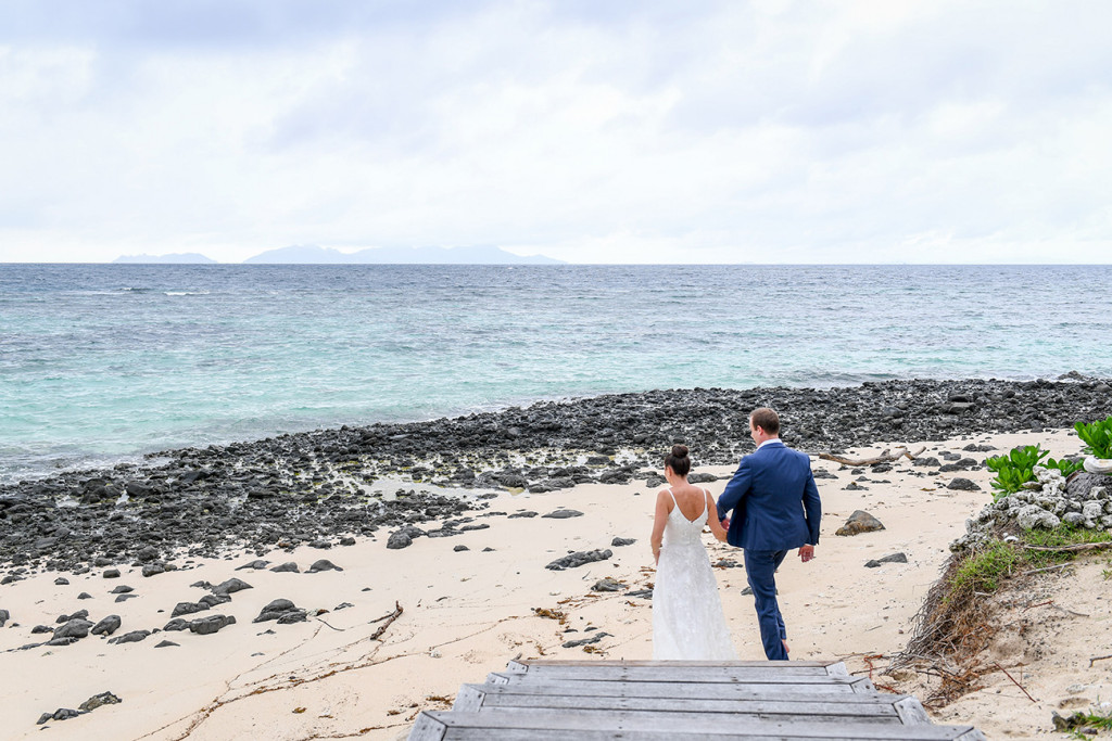 Couple's beach walk at Vomo Island Resort Fiji