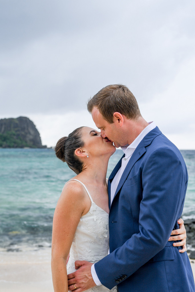Couple's kiss by the sea at Vomo Island Resort Fiji