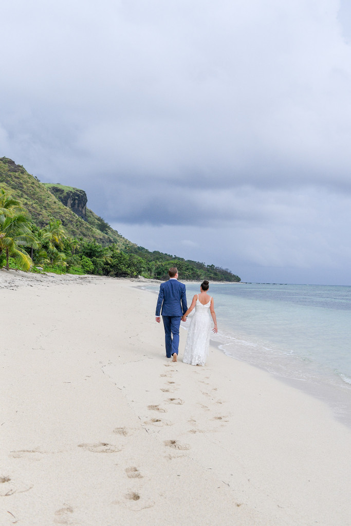 Holding hands along Vomo Island Resort Fiji