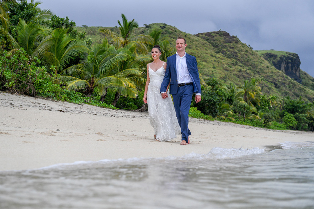 Couple walks by the beach in Vomo Island Resort Fiji