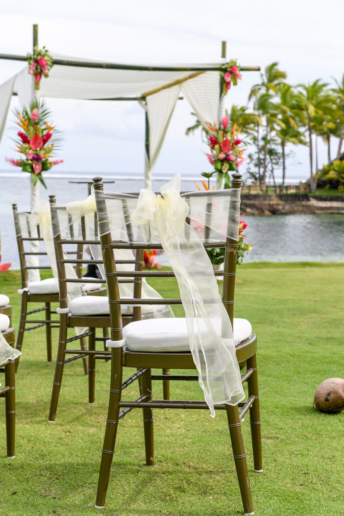 Lace draped over simple chair in stunning Fiji wedding