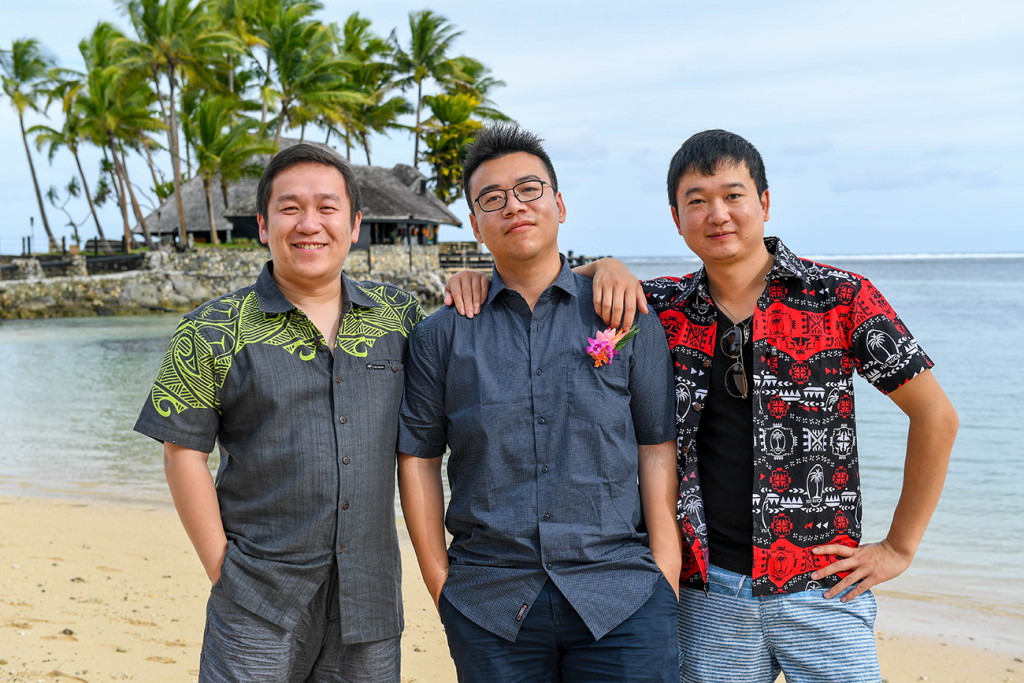 The asian groom poses with his friends on Warwick beach Fiji