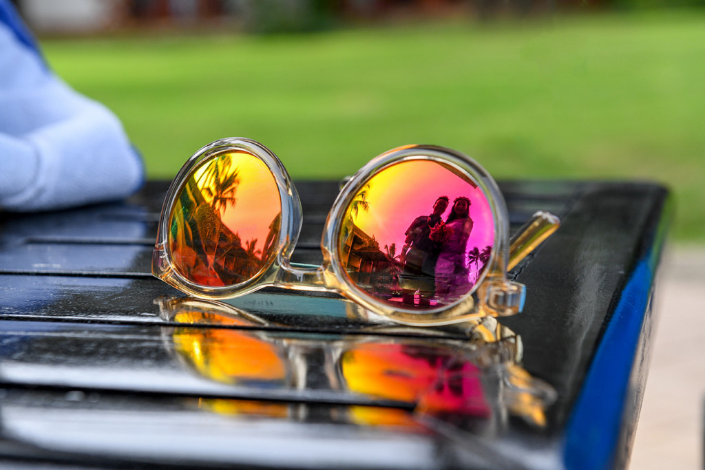Reflect photography - Polarized sunglasses reflecting bride and groom