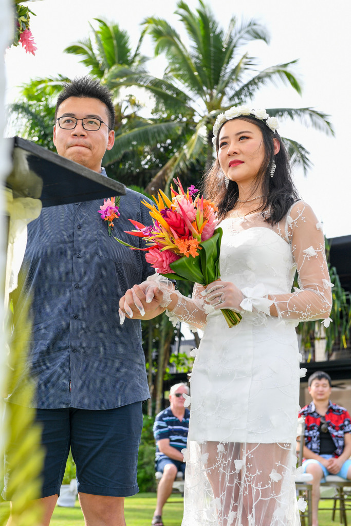 Stunning asian couple married at Warwick beach Fiji at the altar