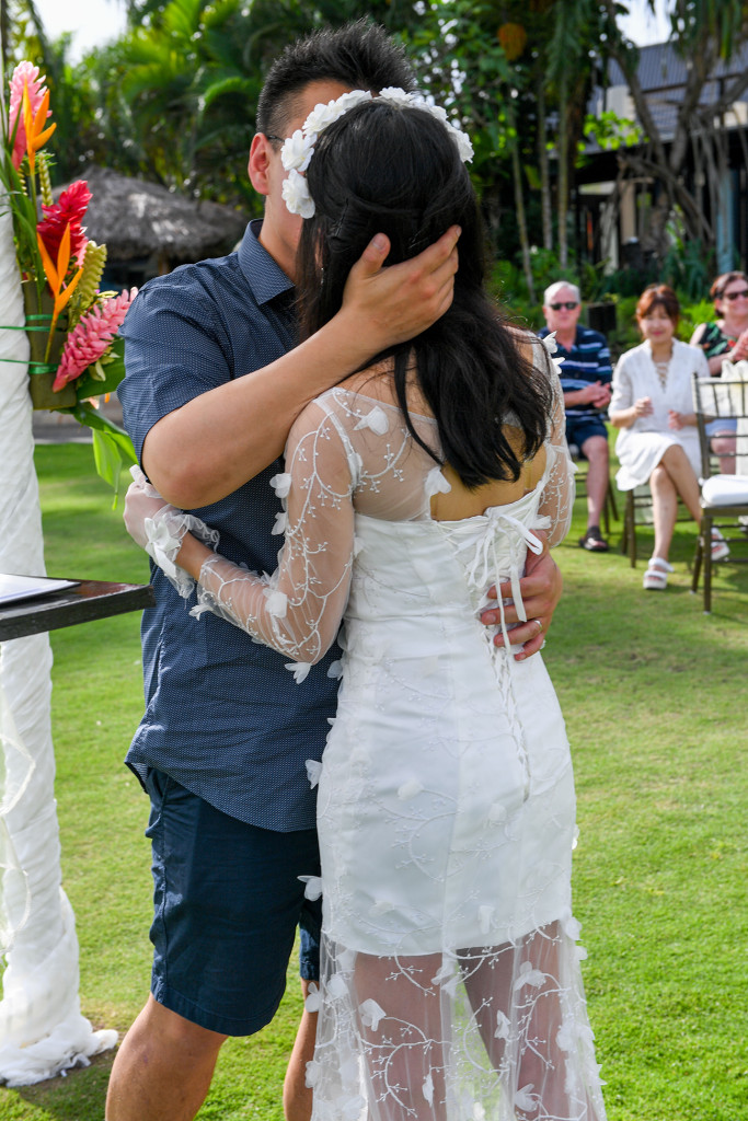 Asian bride and groom kiss at the beach in Warwick Fiji wedding