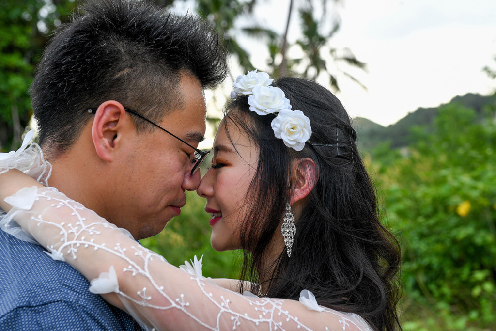 Married asian couple touch noses in Warwick Fiji wedding photoshoot