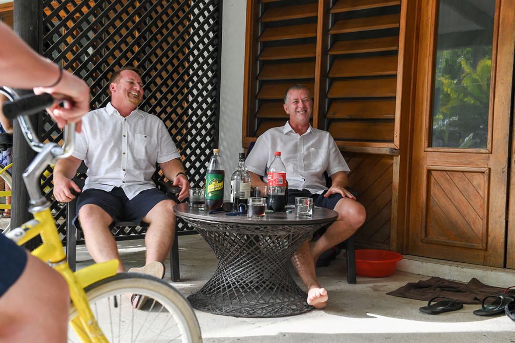 Groom and his brother have spiced rum before tropical island wedding