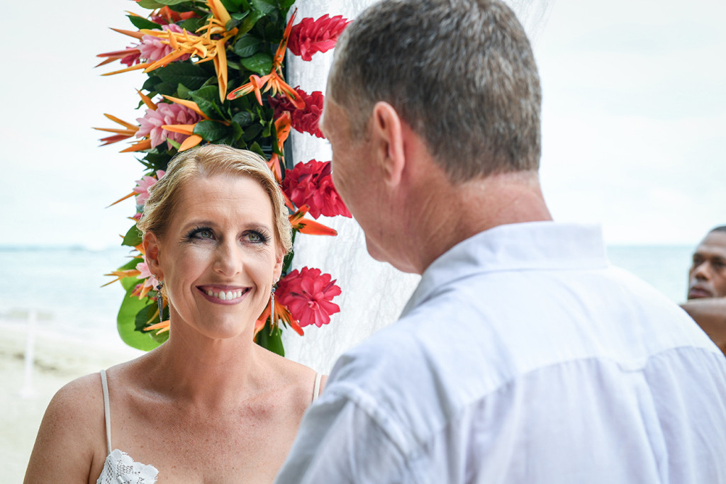Bride smiles at groom at the altar Fiji Tropical wedding