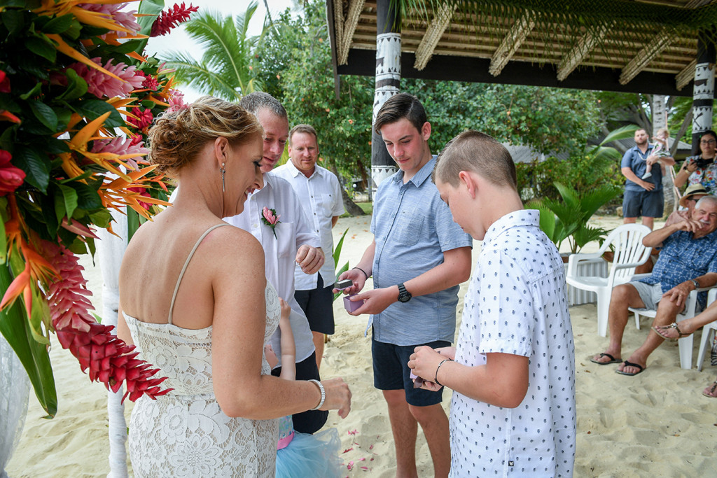 Best boys hands over rings to married couple at Plantation Island Resort Tropical wedding