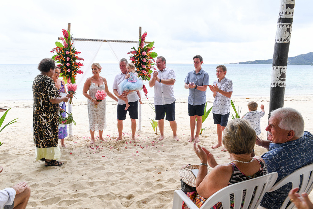 Family at the aisle of Fiji Plantation Island Resort family wedding