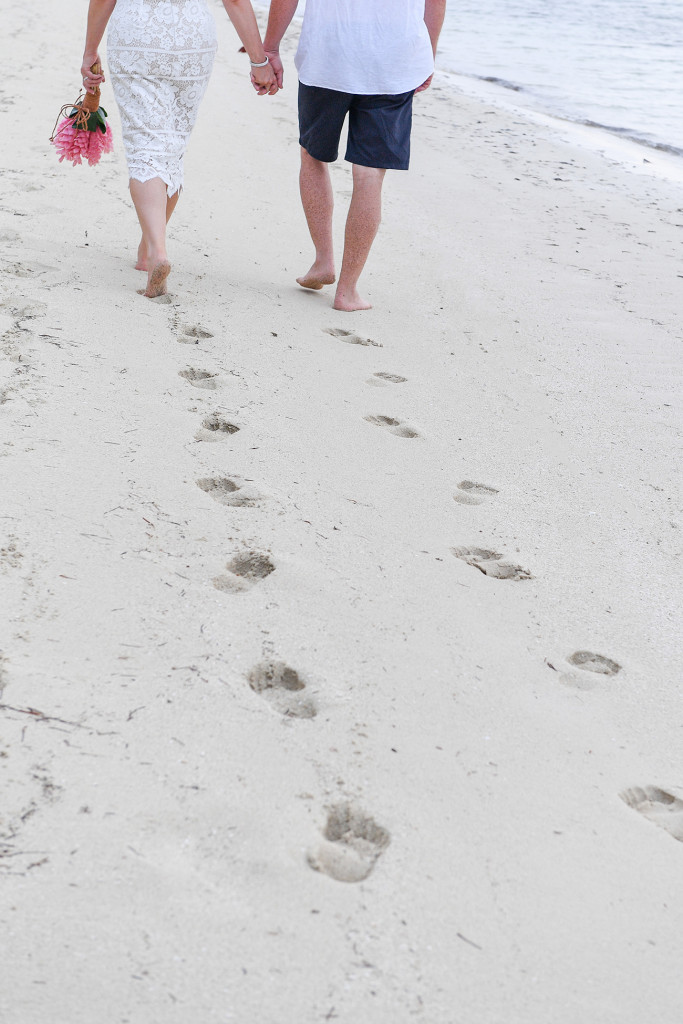 Footprints of newly married couple on the beach in Fiji Plantation Island Resort