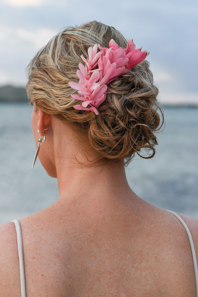 Tropical flower hair band in bride's hair