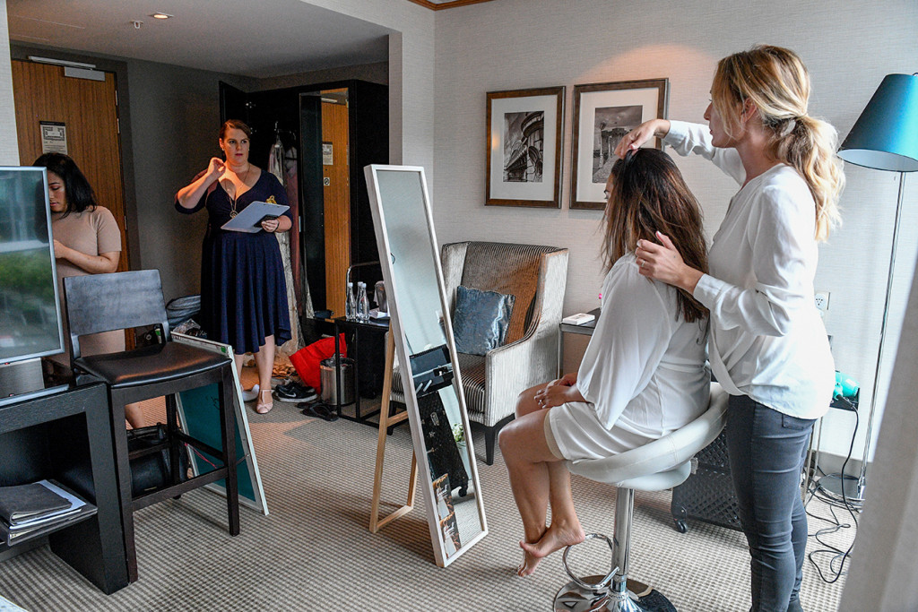 Bridal party having hair & make up done before wedding