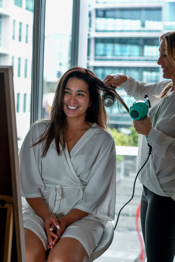 Bride's hair being straightened at the Sofitel Auckland