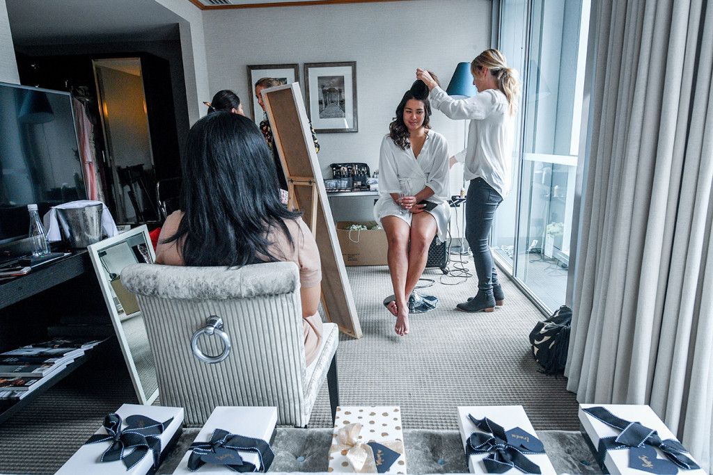 Bride's hair being straightened during prep in the Sofitel Auckland