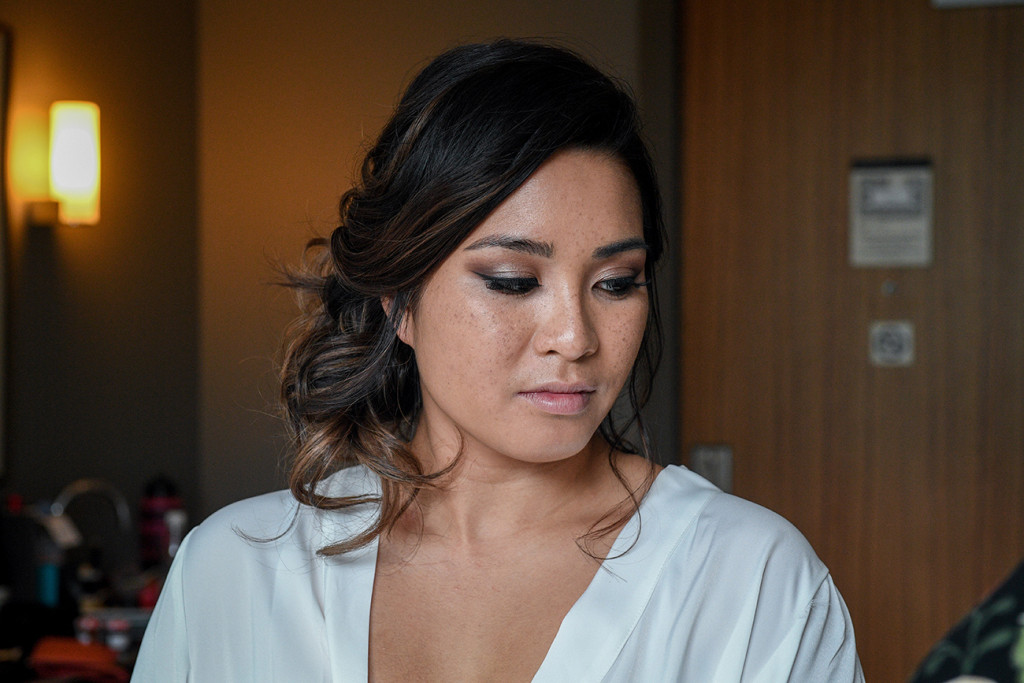 Stunning bride in full make up during wedding preparations