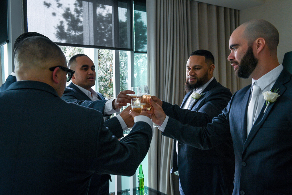 Groomsmen and groom make a champagne toast