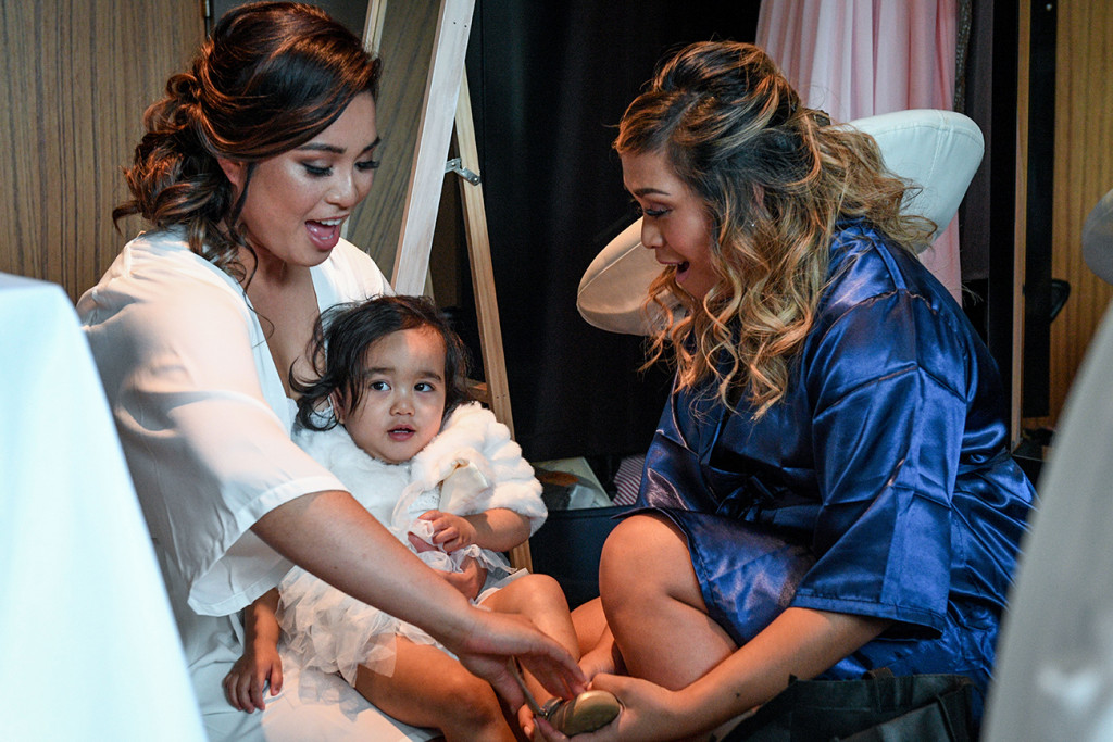 Bride plays with her daughter before the wedding