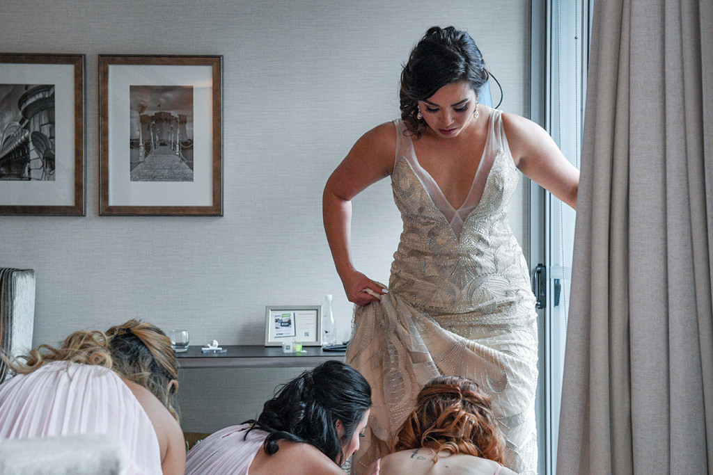 Bride steps into her wedding shoes