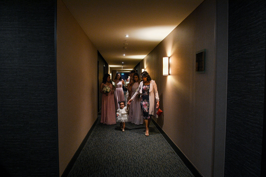 Bridal team in the corridor making way to the ceremony venue