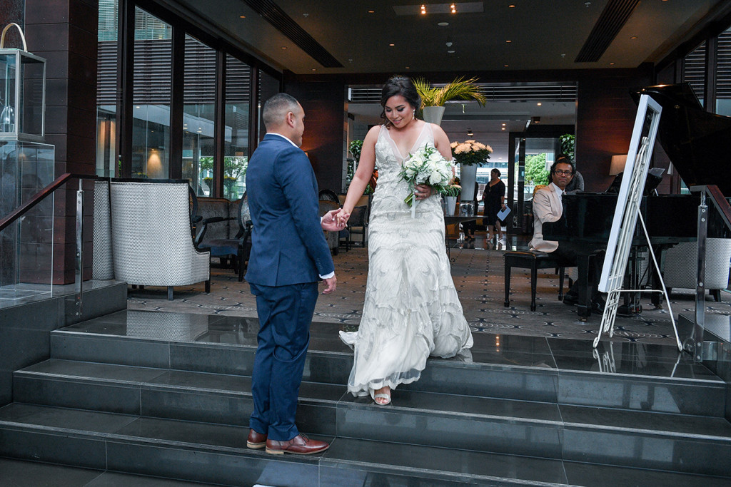 Groom receives his bride at the altar in the Sofitel Auckland