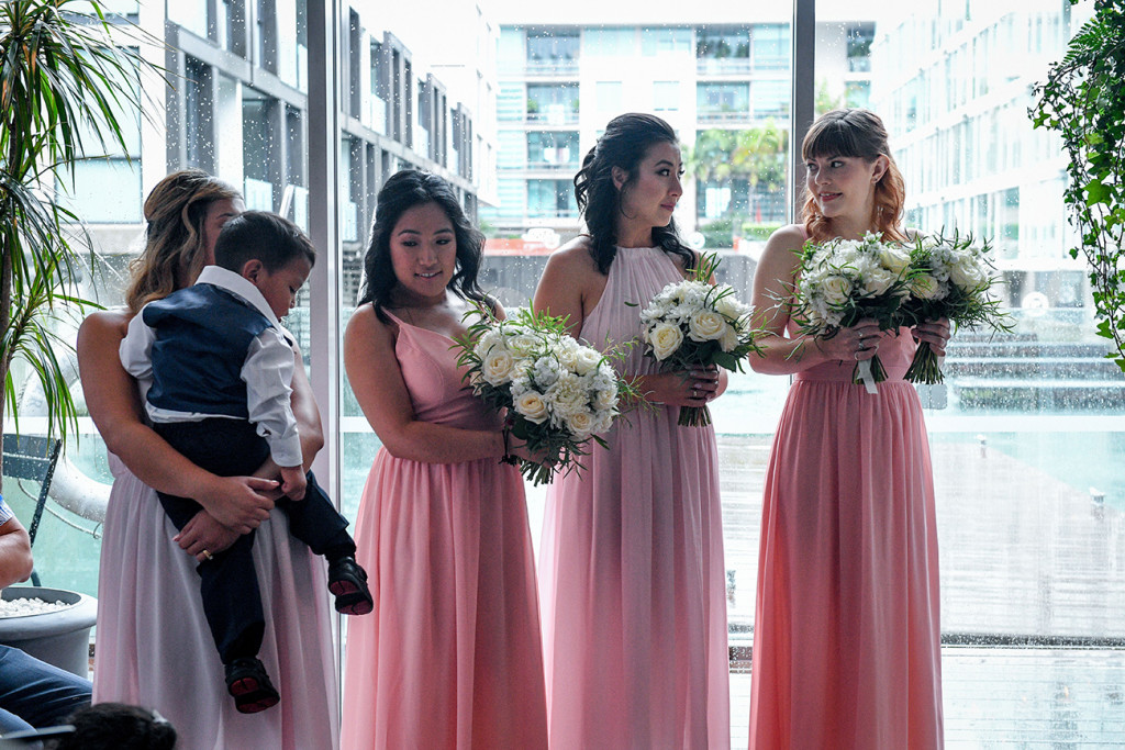 Bridesmaids in pink standing at the altar
