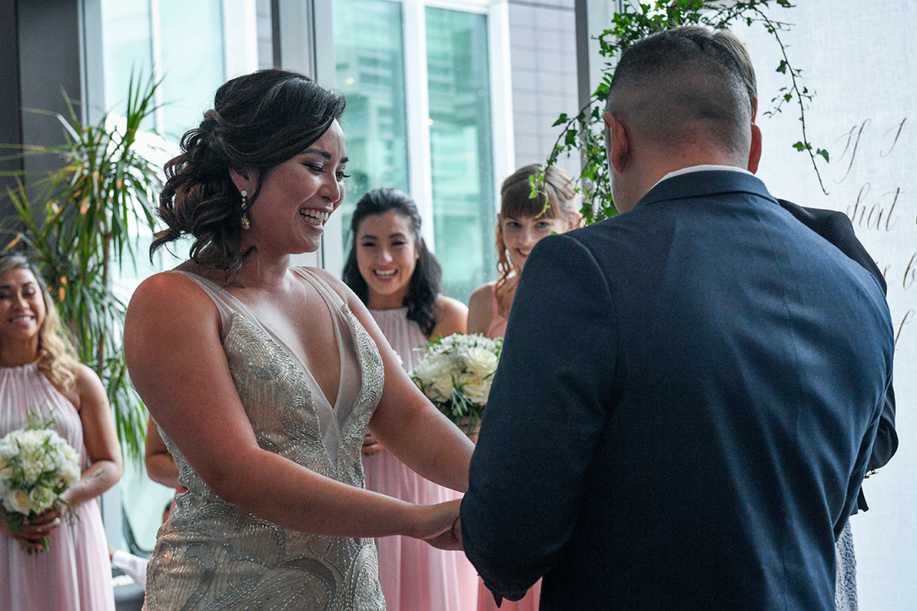 Groom puts the wedding on the bride at the Sofitel Auckland