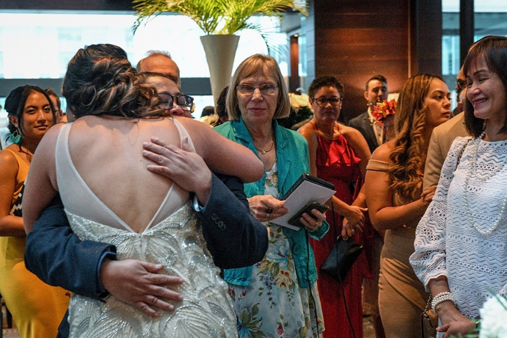 Bride hugs her father at the Sofitel Auckland wedding