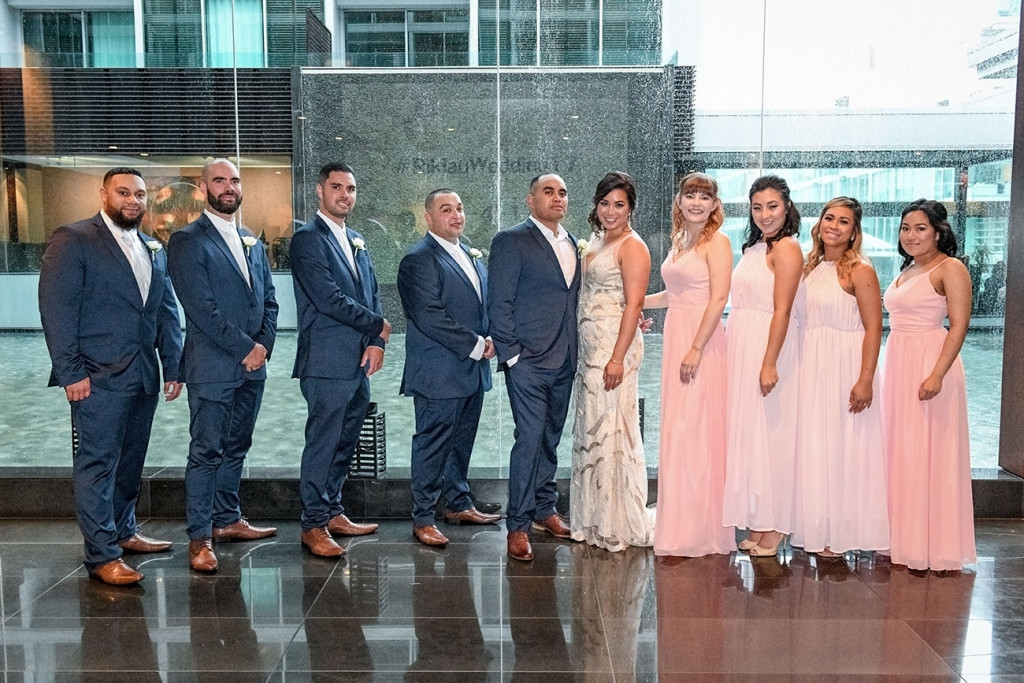 Bride groom and bridal party pose at the Viaduct Sofitel Auckland