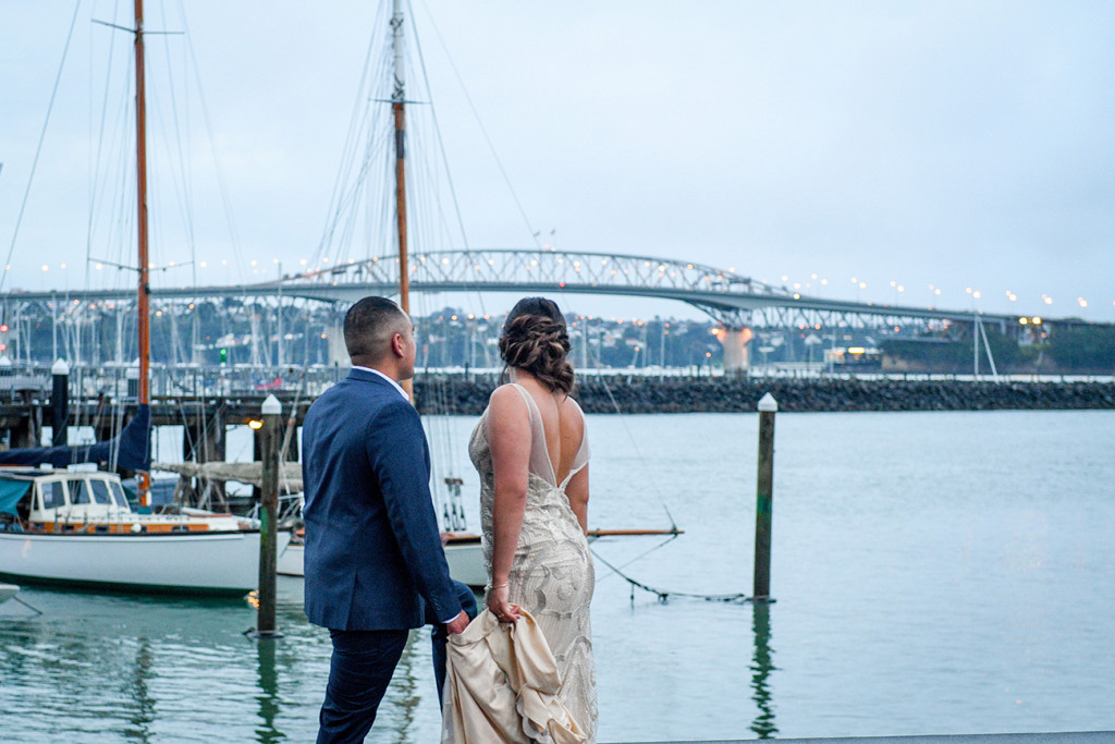 Bride and groom overlook the Auckland viaduct during their wedding shoot