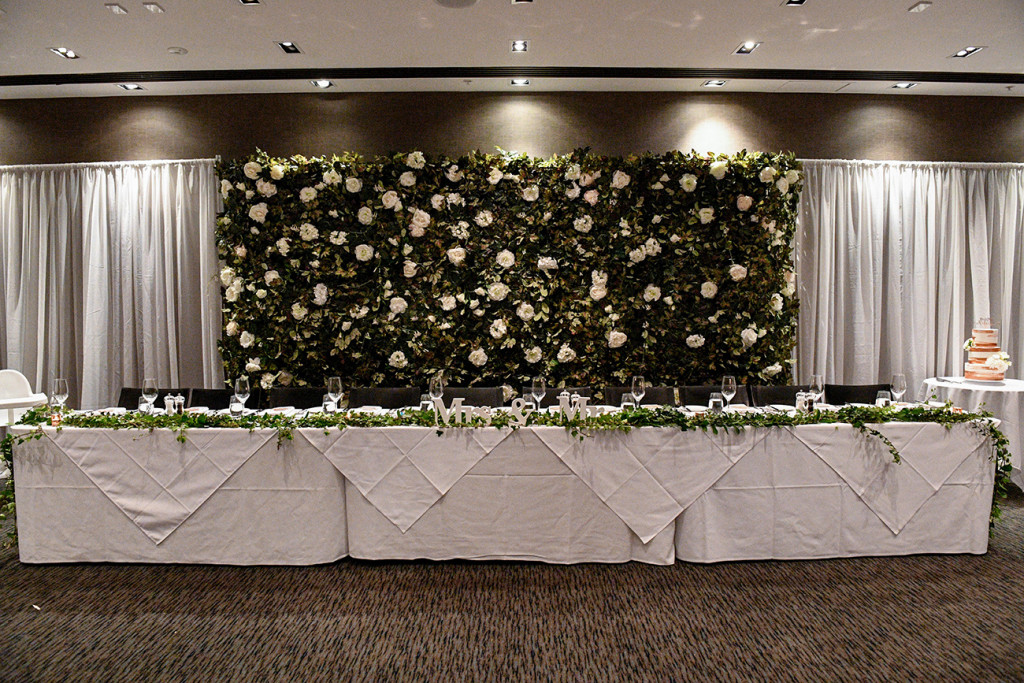 White rose decor at the reception at the Sofitel Auckland