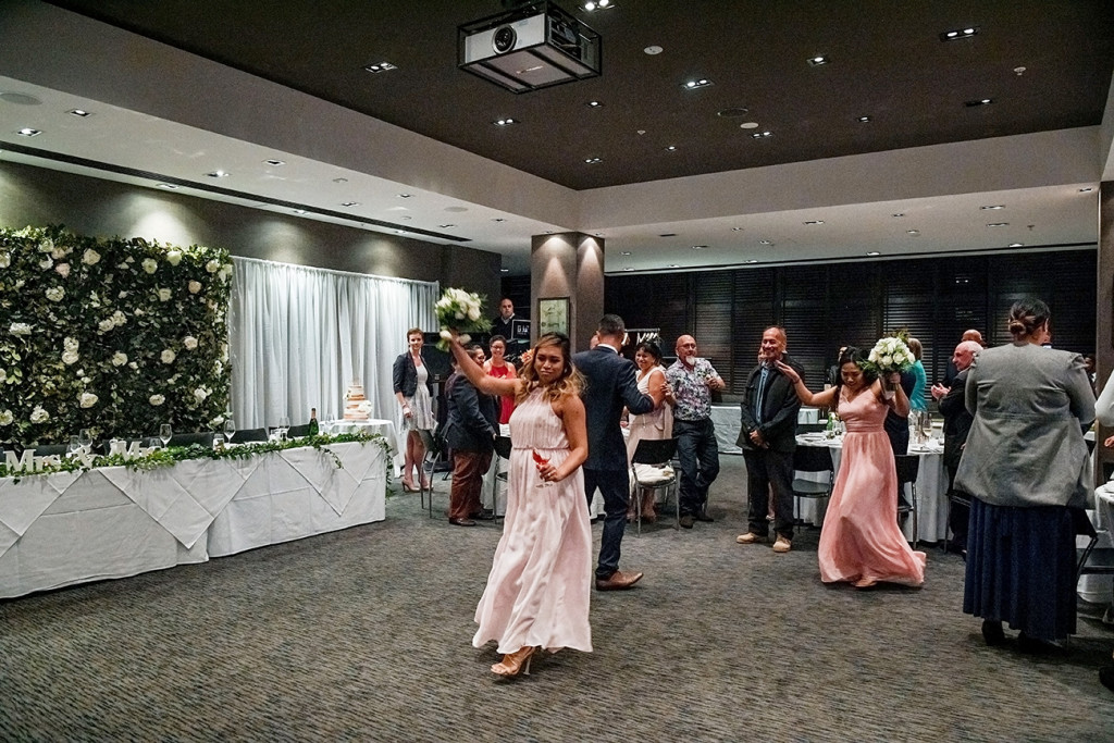 Bride and bridesmaids dance on the floor
