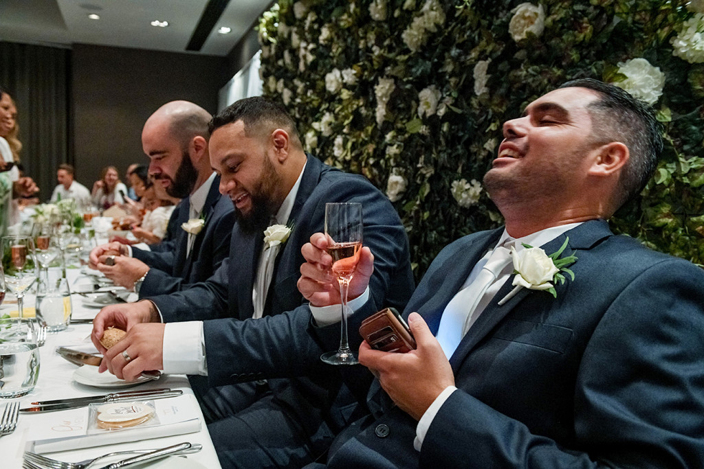 Groomsmen laugh at a toast