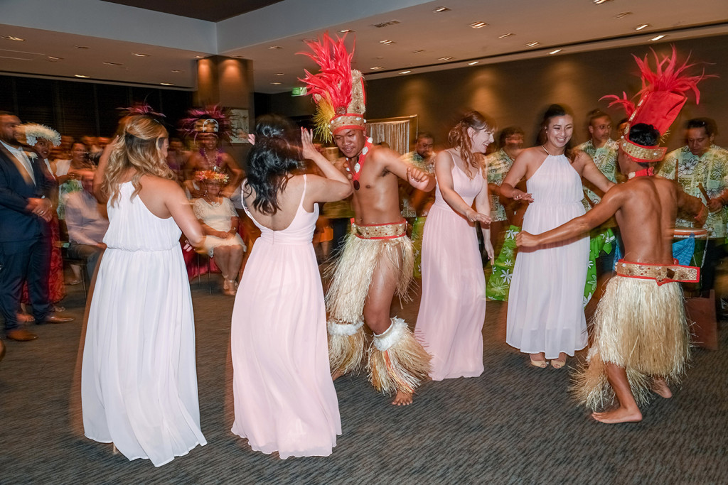 Bridal party join Traditional Polynesian dance performed at the wedding in Sofitel Auckland